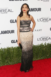 Freida Pinto got dolled up in a Reem Acra gown, featuring a lace bodice, an illusion neckline, and an ombre beaded skirt, for the Glamour Women of the Year 2016.