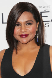 Mindy Kaling gave her black dress a pop of color with a pair of blue gemstone earrings.