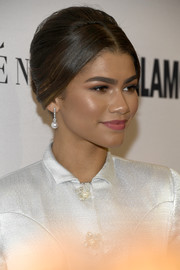 Zendaya Coleman oozed retro elegance wearing this loose center-parted bun at the Glamour Women of the Year 2016.