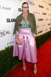Jenna Lyons contrasted her girly blouse and skirt combo with an edgy army-green cropped jacket.
