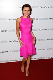 Samantha Barks opted for a fun color with this bright fuchsia frock.
