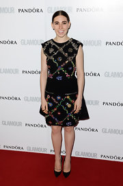 Zosia Mamet chose a cool boho dress when she wore this sleeveless black number that featured embroidered floral designs.