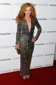 Kelly Hoppen brought out the hardware with this long-sleeve black dress with gold beaded embroidery.
