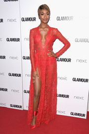 Jourdan Dunn matched her dress with red satin ankle-wrap pumps.