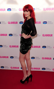 Florence showed off her fire-red hair in a sparkling black mini dress with chunky-heeled pumps.