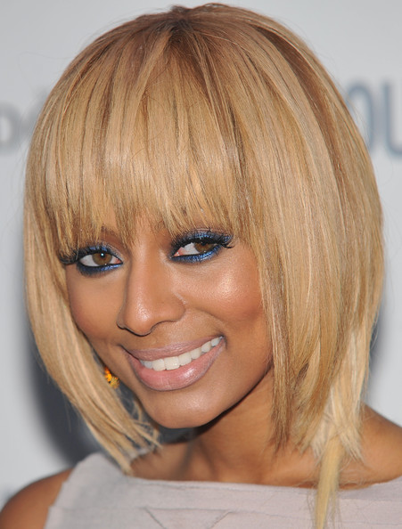 Keri Hilson infused some color into her look by lining her upper and lower lids with metallic sapphire eyeshadow.
