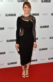 A pair of black Jimmy Choo ankle-strap sandals with bedazzled buckles finished off Ellie Kemper's look.