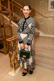 Alison Brie was stylish in black-and-white stripes at the Glamour x Tory Burch Women to Watch lunch.