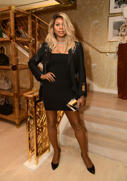 Laverne Cox pulled her look together with a mirrored gold clutch.