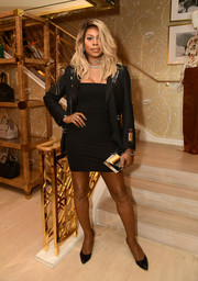 Laverne Cox toughened up her sexy dress with a black 99%IS military jacket.