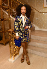 For her bag, Logan Browning chose a stylish cobalt calf-hair purse.