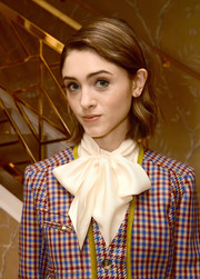 Natalia Dyer attended the Glamour x Tory Burch Women to Watch lunch wearing a bob with the sides tucked behind her ears.