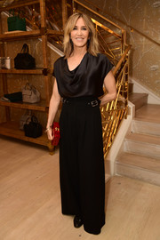 Felicity Huffman joined the Glamour x Tory Burch Women to Watch lunch wearing a black satin cowl-neck top.