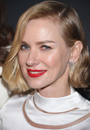 Naomi Watts swiped on some red lipstick for a vibrant pop to her white outfit.