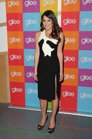 Lea Michele wore elegant black lace peep-toes with satin platforms with her asymmetrical black-and-white dress.