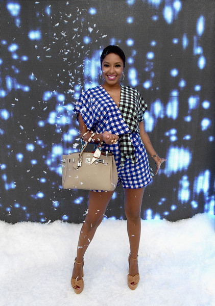 Alicia Quarles styled her romper with nude platform sandals by Rachel Zoe.