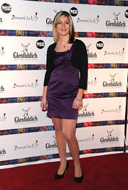 Eve Muirhead wore this cute purple cocktail dress with a black mini cardigan to the Glenfiddich 'Dressed to Kilt' event.
