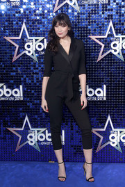 Daisy Lowe donned a cropped black tuxedo jumpsuit for the 2018 Global Awards.