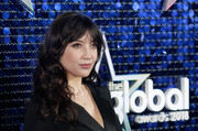 Daisy Lowe looked pretty wearing this curly 'do with parted bangs at the 2018 Global Awards.