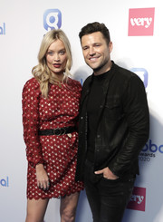 Laura Whitmore teamed her floral mini dress with a black leather belt for the Global Awards 2020.