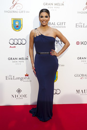 Eva Longoria looked simply divine in a blue one-shoulder gown by Rosa Clará at the Global Gift Gala Marbella 2016.
