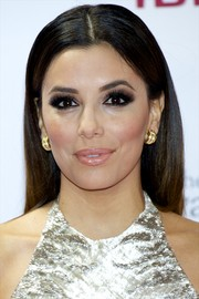 Eva Longoria finished off her look with a pair of chunky gold hoops.