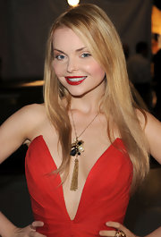 Izabella Miko accented her plunging neckline with a golden pendant necklace.