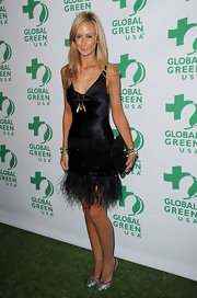 Lady Victoria wears a sleek satin LBD with a feathered hem to the Global Green pre-Oscar party.