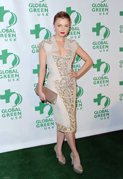 Izabella Miko wore this unique cocktail dress with rich embroidery to the Global Green pre-Oscar party.