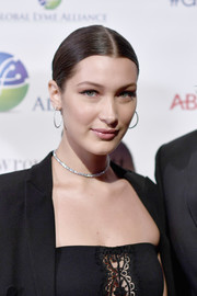 Bella Hadid accessorized with classic diamond hoops.