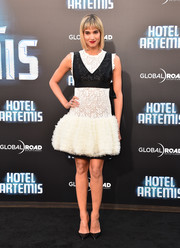 Sofia Boutella glammed up in a white Giambattista Valli Couture lace cocktail dress with a contrast bustline and a poofy skirt for the premiere of 'Hotel Artemis.'