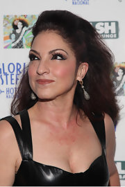 Gloria Estefan was the epitome of a music goddess in a daring teased hairstyle for an appearance at Splash Bar.