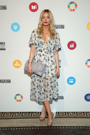 Laura Whitmore looked ultra girly in a V-neck floral dress by Reformation at the Global Goals Awards 2017.