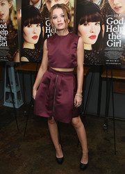 Emily Browning completed her outfit with a matching burgundy skirt.