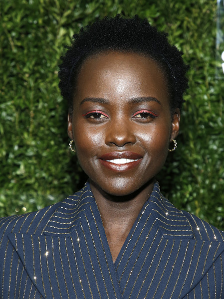 Lupita Nyong'o wore her natural curls at the God's Love We Deliver Golden Heart Awards.