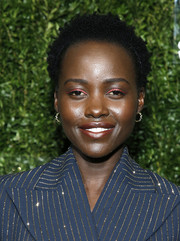 Lupita Nyong'o swiped on some bright pink eyeshadow for a playful beauty look.