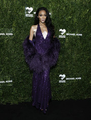 Winnie Harlow looked sultry in a purple sequined halter gown by Michael Kors at the God's Love We Deliver Golden Heart Awards.