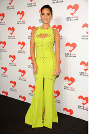 Olivia Munn flaunted her fab physique in a figure-hugging chartreuse cutout dress by Michael Kors during the Golden Heart Awards.