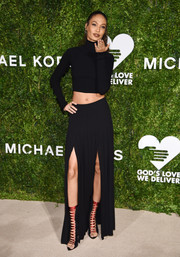 Joan Smalls pulled her sexy look together with a pair of red and black lace-up heels.