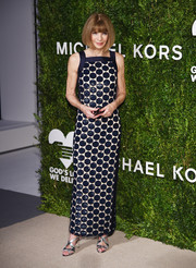 Anna Wintour paired her frock with her favorite Manolo Blahniks, in black and silver.