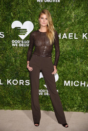 Constance Jablonski completed her monochromatic outfit with a pair of brown slacks, also by Michael Kors.