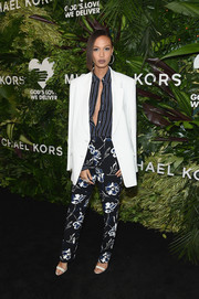 Joan Smalls sported a stylish mix of prints with this floral pants and striped shirt combo by Michael Kors at the Golden Heart Awards.