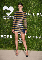 Taylor Hill rounded out her look with a blue croc-embossed envelope clutch.