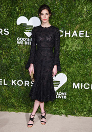 Hilary Rhoda finished off her outfit with strappy black sandals.