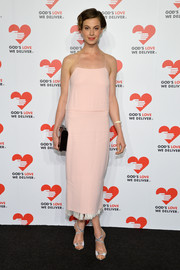 Elettra Wiedemann attended the Golden Heart Awards wearing glam silver cross-strap sandals with a retro pink dress.