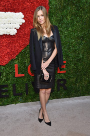 Josephine Skriver tempered her sexy dress with a black satin-lapel blazer.