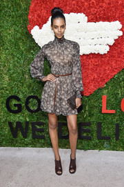 Grace Mahary injected a bit of edge via a pair of brown open-toe booties, also by Michael Kors.