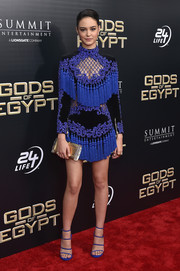Courtney Eaton finished off her outfit with a metallic gold clutch by Edie Parker.