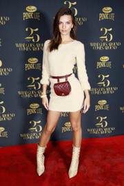 Emily Ratajkowski punctuated her neutral outfit with a quilted red belt bag by Chanel.