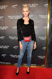 Karlie Kloss styled her look with a quilted red belt bag by Chanel.